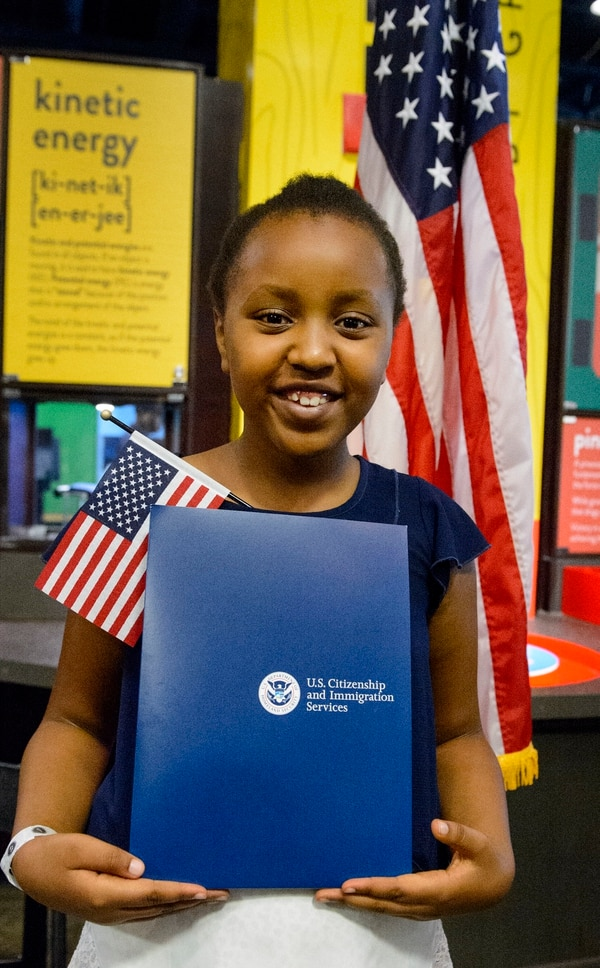 (Steve Griffin   The Salt Lake Tribune) Yguette Umutesi, age 9, smiles as she gets her picture taken as children, ages 7 to 14, had a very special day at Discovery Gateway: the ChildrenÕs Museum of Utah Monday when they received citizenship certificates from the Salt Lake County and U.S. Citizenship and Immigration Services during the ceremony in Salt Lake City Monday August 7, 2017.