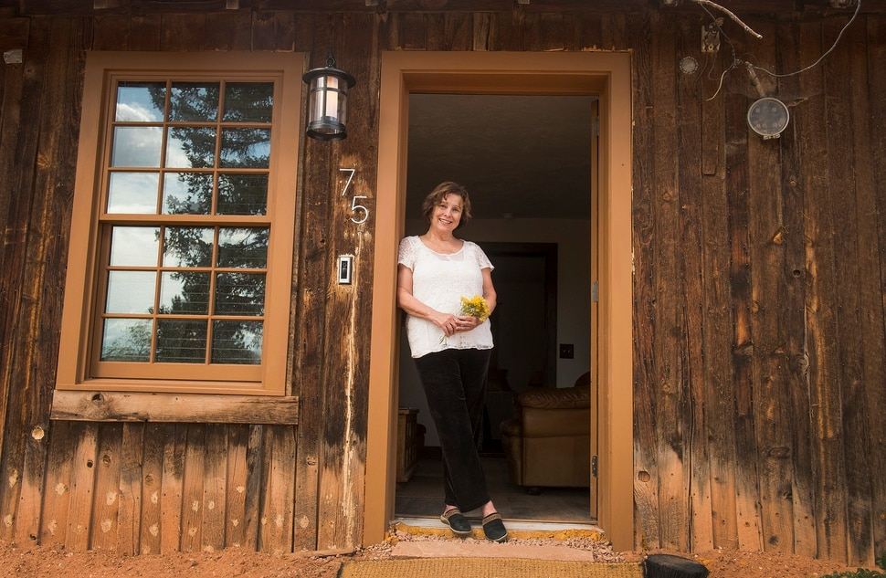 (Leah Hogsten | The Salt Lake Tribune) The board and batten frontier house, originally just one room, was dilapidated and boarded up and had sat vacant for 50 years, when Dawn House purchased the 1886 home in Torrey three years ago. House and her family painstakingly numbered and catalogued every board in the home to ensure its placement in its original spot. The soft pine boards still show bleached boards, where the snow drifts piled on the cabin's front since 1886.