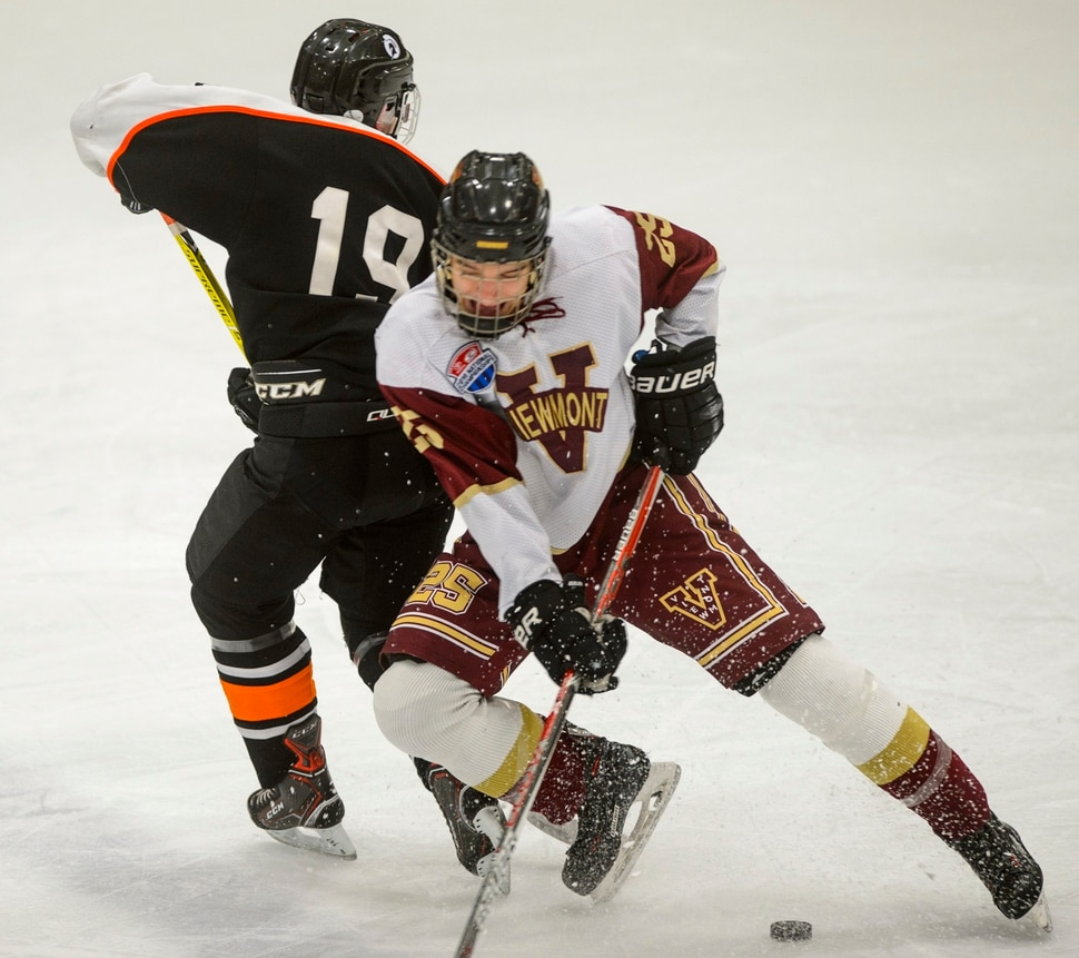 (Steve Griffin | The Salt Lake Tribune) Viewmont's Zac Boam, right, crashes into Murray's Stewart McKenna during the Division 1 ice hockey state title game at the Salt Lake City Sports Complex in Salt Lake City Tuesday Feb. 20, 2018.Stewrat McKenna