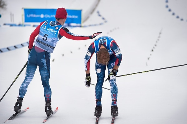 (Scott Sommerdorf | The Salt Lake Tribune) Nordic Combined Olympic Trials winner Bryan Fletcher, left, gives his brother Bryan Fletcher a pat on the back after Bryan came in to finish fourth in the 10K cross country race in the in Park City, Saturday, December 30, 2017.