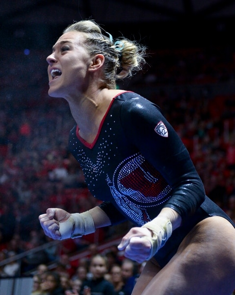 (Leah Hogsten | The Salt Lake Tribune) Tiffani Lewis celebrates her vault routine as the No. 4 Utah gymnasts host No. 20 Georgia in the final regular season meet at Jon M Huntsman Center in Salt Lake City Friday, March 16, 2018.