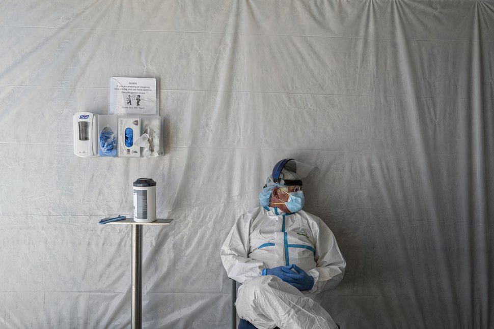 (Adriana Zehbrauskas | The New York Times) A doctor waits to administer coronavirus tests inside a tent at the Gallup Indian Medical Center in Gallup, N.M., on May 26, 2020.