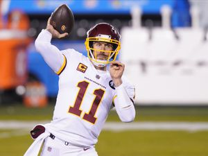 (AP File Photo) | Washington Football Team quarterback Alex Smith warms up before an NFL football game against the Philadelphia Eagles in Philadelphia, in this Sunday, Jan. 3, 2021, file photo. Smith, the former Utah great and No. 1 draft pick, announced his retirement on Monday.
