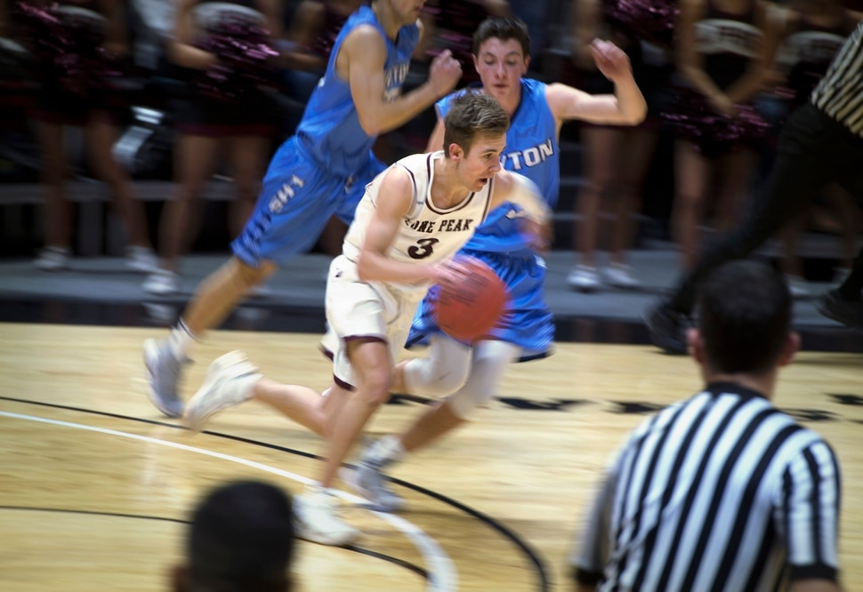 Scott Sommerdorf | The Salt Lake Tribune Lone Peaks' Steven Ashworth brings up the ball during first half play. Lone Peak beat Layton 82-47, in a boy's 6A semi-final, FrIday, March. 2, 2018.