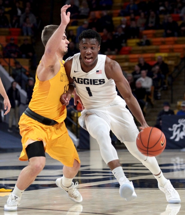 Utah State's Koby McEwen, right, collides with Wyoming's Cody Kelley during an NCAA college basketball game, Saturday, Feb. 11, 2017, in Logan, Utah. (John Zsiray/Herald Journal via AP)