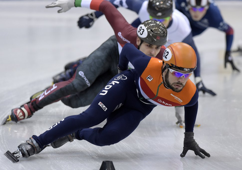 Winner Sjinkie Knegt of the Netherlands, front, skates during the men 1,500 meters final race at the World Cup short track speed skating championship in Dresden, eastern Germany, Sunday, Feb. 5, 2017. (AP Photo/Jens Meyer)