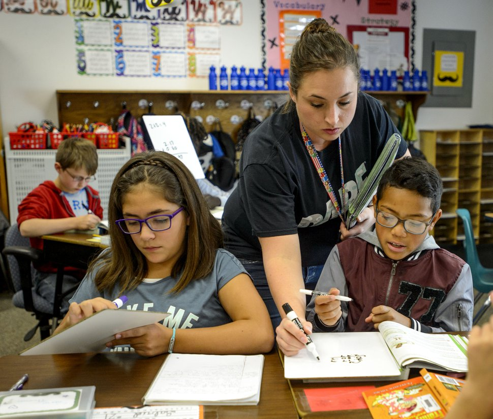 (Steve Griffin | The Salt Lake Tribune) Raschell Davis works with her fifth-grade students at East Midvale Elementary School in Midvale, Utah Monday September 25, 2017. The school improved by two letter grades in the latest release of school grading.