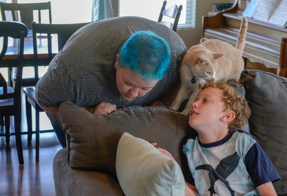 (Leah Hogsten | The Salt Lake Tribune) Kris Irvin leans into their son as Toby whispers a question. After a lifetime of feeling like they were born into the wrong body, Kris Irvin came out as transgender three years ago at the age of 28.
