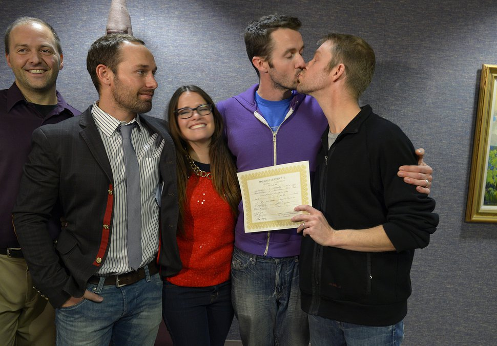 (Scott Sommerdorf | Tribune file photo) Michael Ferguson kisses his husband Seth Anderson after they became the first gay couple in Utah to be married on Dec. 20, 2013, after a court decision allowed it.