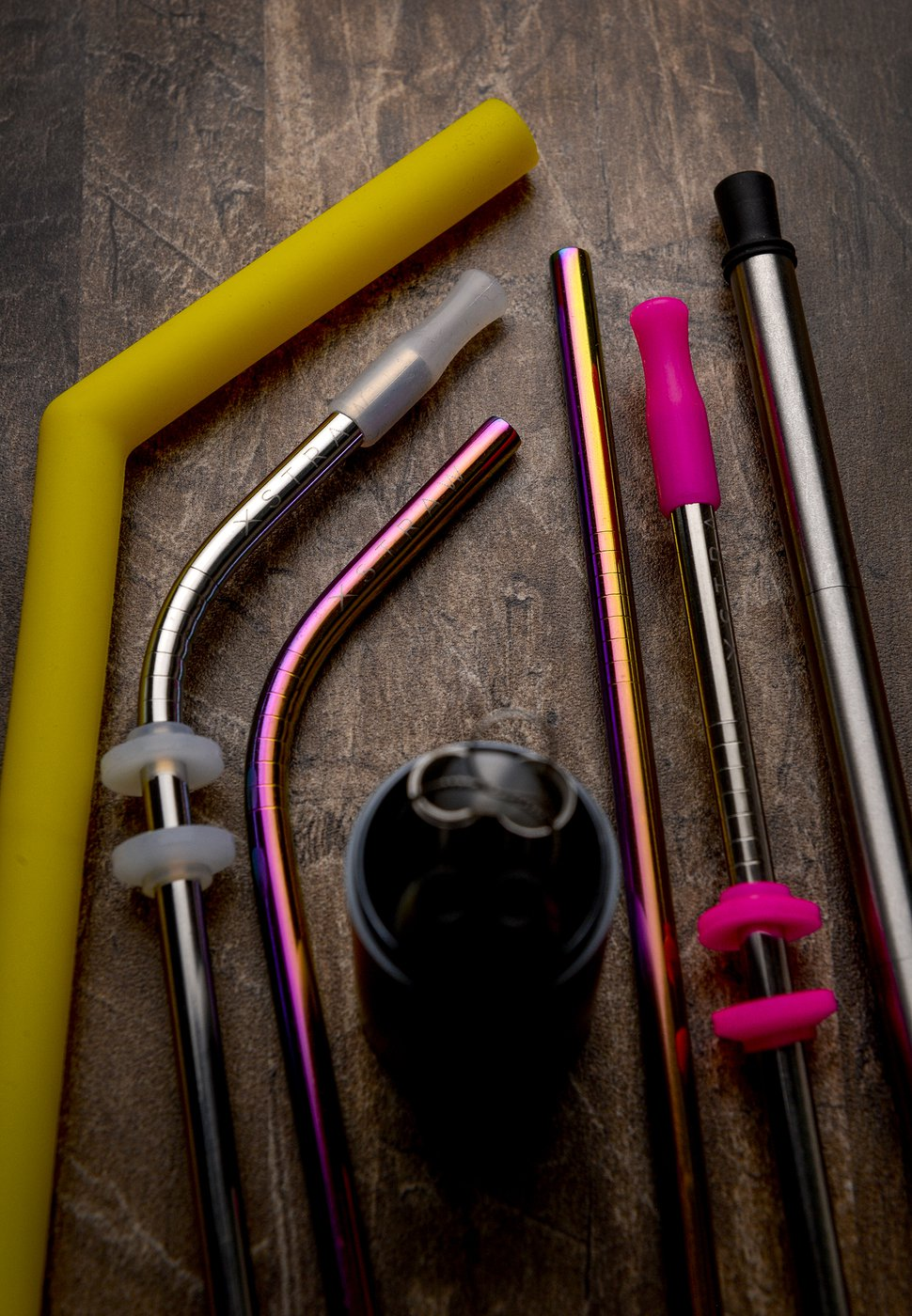 Leah Hogsten | The Salt Lake Tribune Left to right, X-Straw's soft silicone straw that is offered in a variety of colors, a silicone soft-tipped bent stainless steel straw, a bent stainless steel straw, a straight stainless steel straw and silicone soft-tipped straight stainless steel straw and a collapsible straw. Restaurants in Utah and around the country are ditching plastic straws to better the environment. Jason Brailow and Chad Beals, co-owners of L7 Labs in South Jordan, are selling silicone, stainless steel and collapsible straws through a new internet company, X-Straw.