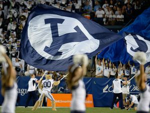 (Francisco Kjolseth  |  The Salt Lake Tribune)  Cosmo gets the fans excited during the second half of the NCAA college football game, Saturday, Sept. 8, 2018, at LaVell Edwards stadium in Provo, Utah. BYU announced Friday that fans will be welcomed back to LaVell Edwards Stadium at full capacity for the 2021 football season.