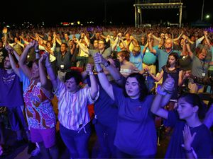 (Chris Seward | AP file photo)Audience members join hands in worship at the the Rev. Franklin Graham's Decision America event at the Pitt County Fairgrounds in Greenville, N.C. on Wednesday, Oct. 2, 2019. A Pew study shows that white evangelicals are the most likely to say they've been harassed online for their religious views.