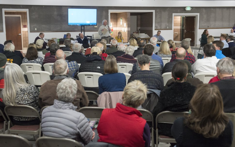 (Rick Egan | The Salt Lake Tribune) Hundreds of concerned citizens gather at the St Vincent De Paul Catholic School for a public hearing about the developers plans for the old Cottonwood Mall site. Wednesday, December 13, 2017.