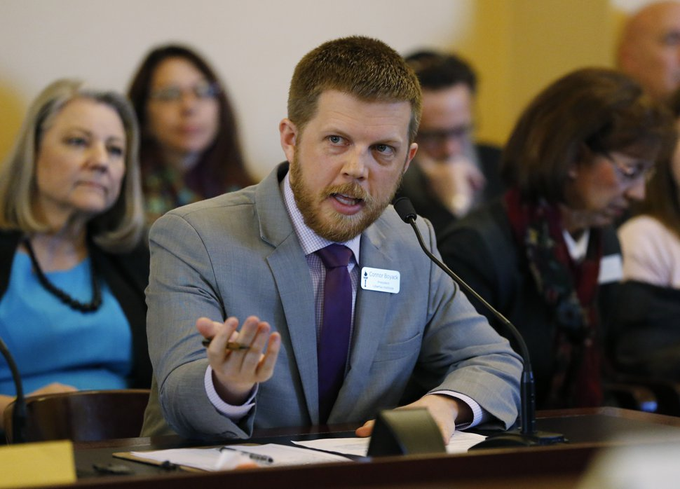 Connor Boyack, with the libertarian-leaning group Libertas Institute, speaks to the members of the Senate Judiciary, Law Enforcement, and Criminal Justice Standing Committee at the Utah State Capitol ,Thursday, Feb. 21, 2019, in Salt Lake City. A panel of lawmakers is approving a proposal to strengthen Utah's hate-crimes law, a key step forward for the idea long stuck in legislative gridlock. (AP Photo/Rick Bowmer)