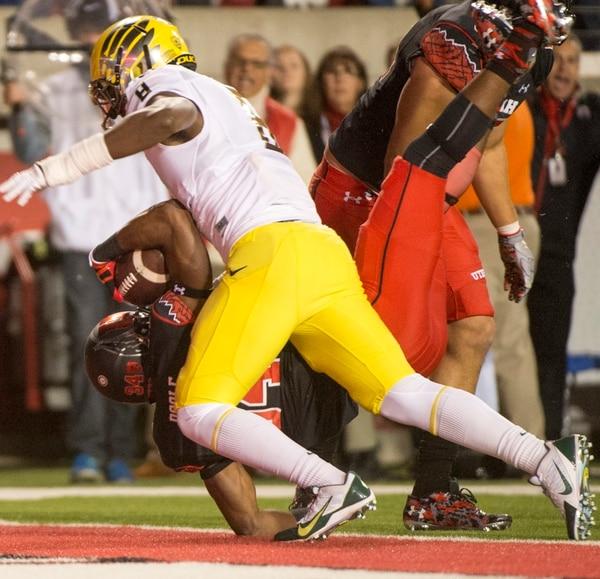 Rick Egan | The Salt Lake Tribune Utes running back Bubba Poole (34) scores a Utah touchdown, in PAC-12 action, Utah vs. Oregon game, at Rice-Eccles Stadium, Saturday, November 8, 2014