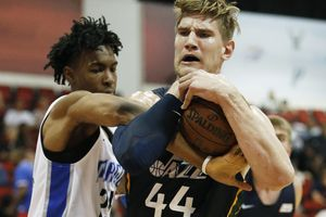 Utah Jazz's Isaac Haas, right, battles for the ball with Orlando Magic's Wes Iwundu during the first half of an NBA summer league basketball game Thursday, July 12, 2018, in Las Vegas. (AP Photo/John Locher)