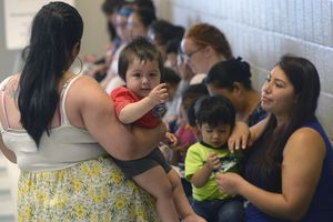 (Al Hartmann     Tribune file photo) This July 2017 file photo shows mothers with their children waiting in line to get immunization shots at the Horizonte Center in Salt Lake City. Advocates say Utah is in its 30th year of having the highest percentage of uninsured Latino kids in the nation. Some bills in the Legislature aim to boost coverage for all children.