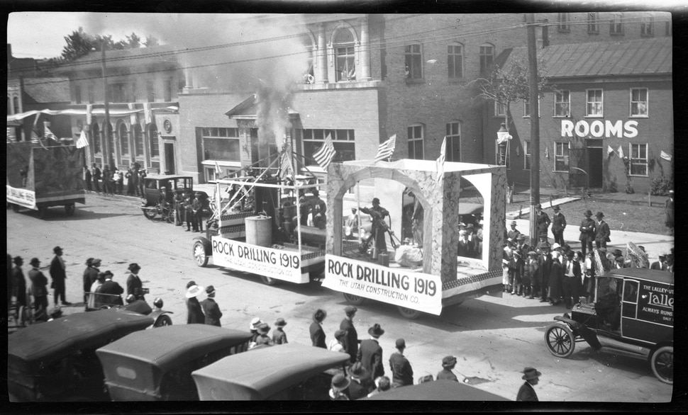 "(Photo courtesy Stewart Library, Special Collections) A Utah Construction Company float is seen in 1919 during a parade in Ogden to mark the 50th anniversary of the completion of the transcontinental railroad. Photographs taken during the parade are featured in Spike 50: Golden Spike Parade in 1919,"" a free exhibit at Union Station, 2501 Wall Ave., Ogden, through May 31."