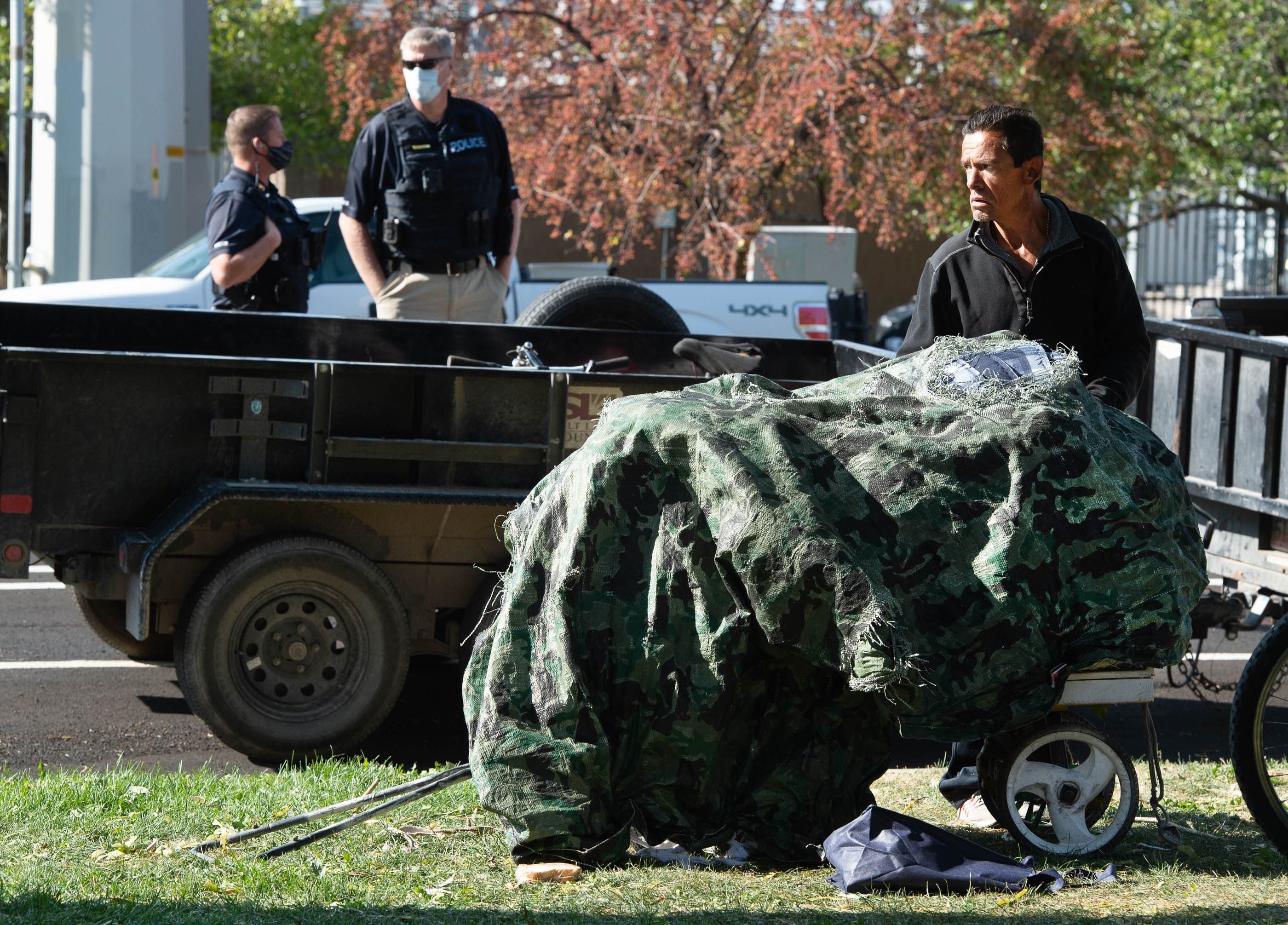 (Francisco Kjolseth  |  The Salt Lake Tribune) Daniel Castiano is forced to pack up his belonging as the Salt Lake County Health Department cleans up the homeless camp set up near Taufer Park in Salt Lake City on Thursday, Sept. 10, 2020. Notified the day before, the health department, backed by police, cleaned up the camps as homeless advocates confronted the police abhorring their actions.