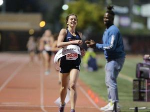 (Photo courtesy of Frank Bellino/MileSplit California ) Carlee Hansen of Woods Cross High crosses the finish line in a long distance race. Hansen, a junior, won the Gatorade Utah Girls' Track and Field Athlete of the Year award.