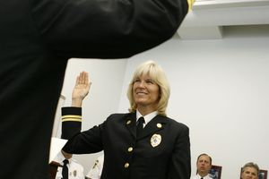 Salt Lake City - Martha Ellis is sworn in after being promoted to the rank of Division Chief for Salt Lake, becoming the department's Fire Marshall. Ellis is also the first female promoted to the position in the Salt Lake Valley in the history of fire department.  Photo by Francisco Kjolseth/The Salt Lake Tribune 5/7/2009