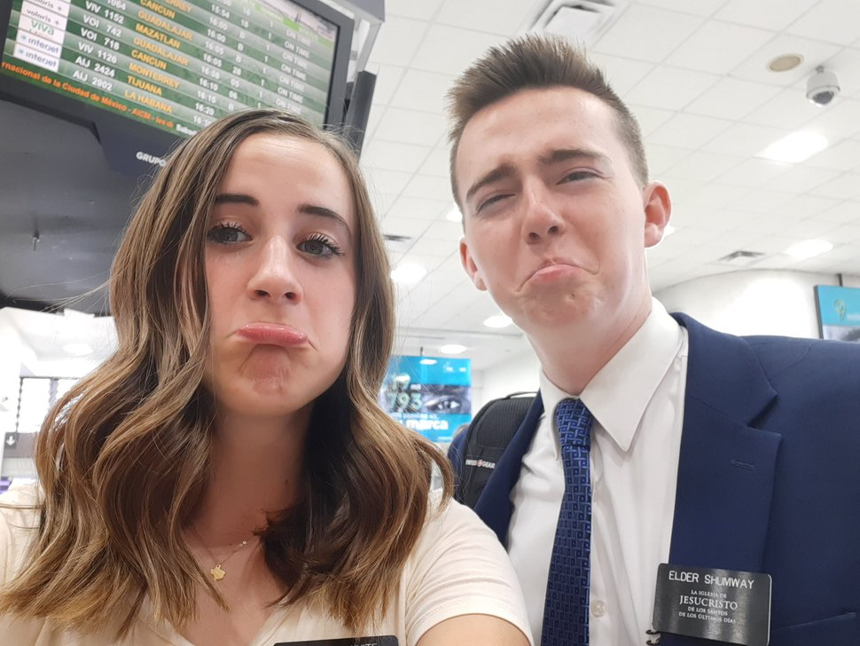 (Photo courtesy of Janet Shumway) Elder Benjamin Shumway with a sister missionary, both of whom had been at the Missionary Training Center in Mexico, find out at the Los Angeles International Airport that they are going home.