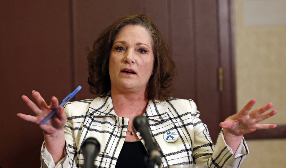 (AP Photo/Rick Bowmer, File) In this April 5, 2018, file photo plaintiff McKenna Denson speaks with reporters during a news conference in Salt Lake City.