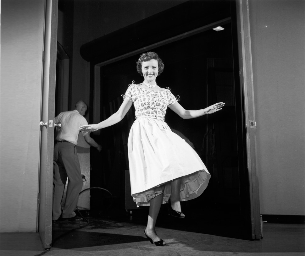 """(Photo courtesy of Pioneers of Television Archives) Betty White enjoying an off-camera moment on an early version of """"The Betty White Show."""""""