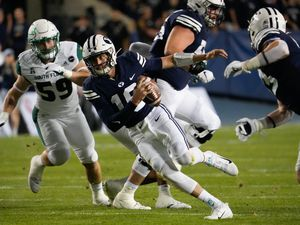 (Francisco Kjolseth | The Salt Lake Tribune) Brigham Young Cougars quarterback Baylor Romney (16) runs in ball in game action between the Brigham Young Cougars and the South Florida Bulls at LaVell Edwards Stadium in Provo, Saturday, Sept. 25, 2021.