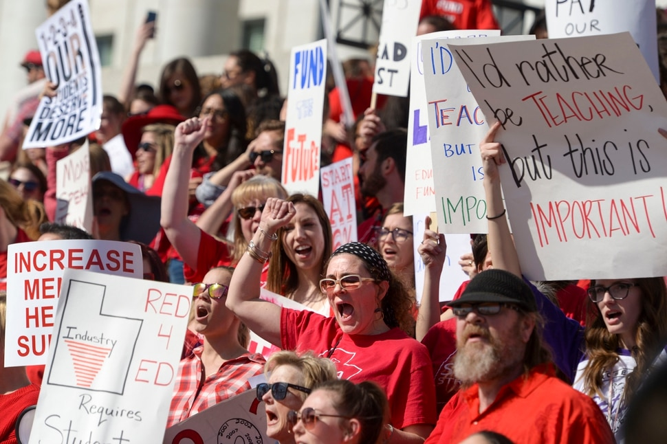 (Leah Hogsten | The Salt Lake Tribune) Jennifer Woznick and fellow teachers from Meadowlark Elementary rally with 1,500 educators and supporters at the Capitol on Friday. Teachers in Salt Lake City's teacher's union stage a walkout and rally at the Capitol to protest teacher pay in an effort to pressure the Utah State Legislature as it decides how much money it will allocate to the state's education system. Teachers began the rally at the Federal Building and walked up Capitol Hill to the statehouse for a rally in the rotunda, Feb. 28, 2020.