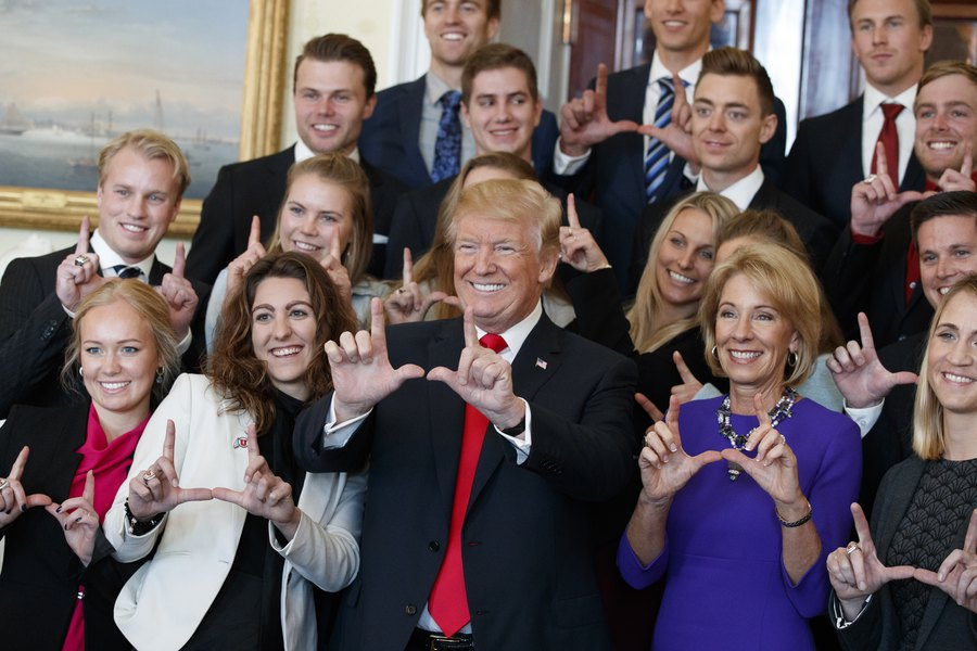 president trump flashes the u sign as university of utah ski team