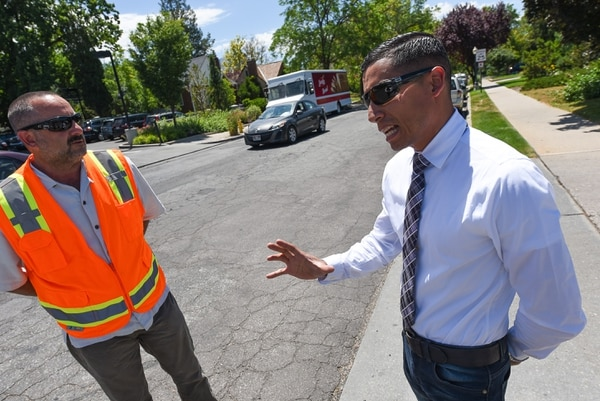 (Francisco Kjolseth | The Salt Lake Tribune) Matt Cassel, city engineer, left, and Adan Carrillo, a civic engagement specialist, discuss the differences between streets that need to be maintained and streets that need to be completely rebuilt during a recent tour of trouble areas and new roads in Salt Lake City on Monday, July 2, 2018. The Salt Lake City Council is on track to authorize a November referendum seeking voter approval for an $87 million bond to fund up to 10 years of catch-up road repairs. The new money for roads would more than double the amount of maintenance the city could do each year — from 75 to 155 lane miles.