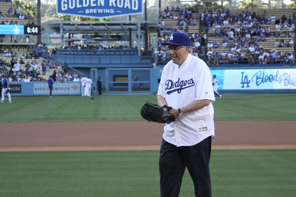 (Photo courtesy of The Church of Jesus Christ of Latter-day Saints) Apostle Neil L. Andersen throws the first pitch as the Los Angeles Dodgers take on the Miami Marlins during The Church of Jesus Christ of Latter-day Saints Family Night at Dodger Stadium, Friday, July 19, 2019.