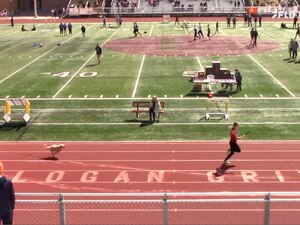 Screenshot of a video that shows a dog running after Logan High senior Gracie Laney during the Grizzly Invitational in Logan, Utah, on April 17, 2021.