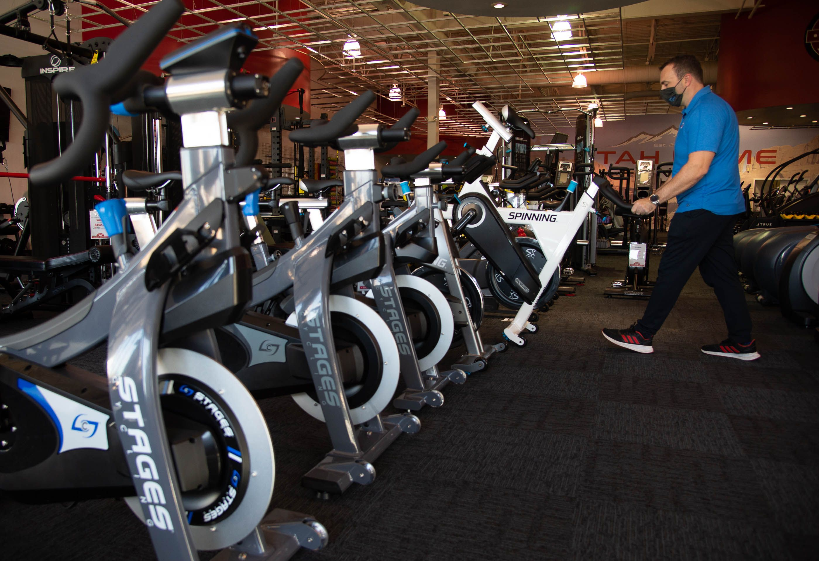 (Francisco Kjolseth  |  The Salt Lake Tribune) Clint Eisinger, operations manager at Utah Home Fitness in Sandy, has seen brisk sales of stationary bikes as the staff takes advantage of a slow moment to catch up on restocking inventory on Wednesday, Oct. 22, 2020. Home fitness equipment sales boomed in March and April when gyms closed because of the coronavirus. Everything from inexpensive dumbbells to premium treadmills and ellipticals were wiped out of stores and warehouses. Record sales continue throughout the summer — normally the slow time for the industry, and store owners expect sales to remain high during the holidays.