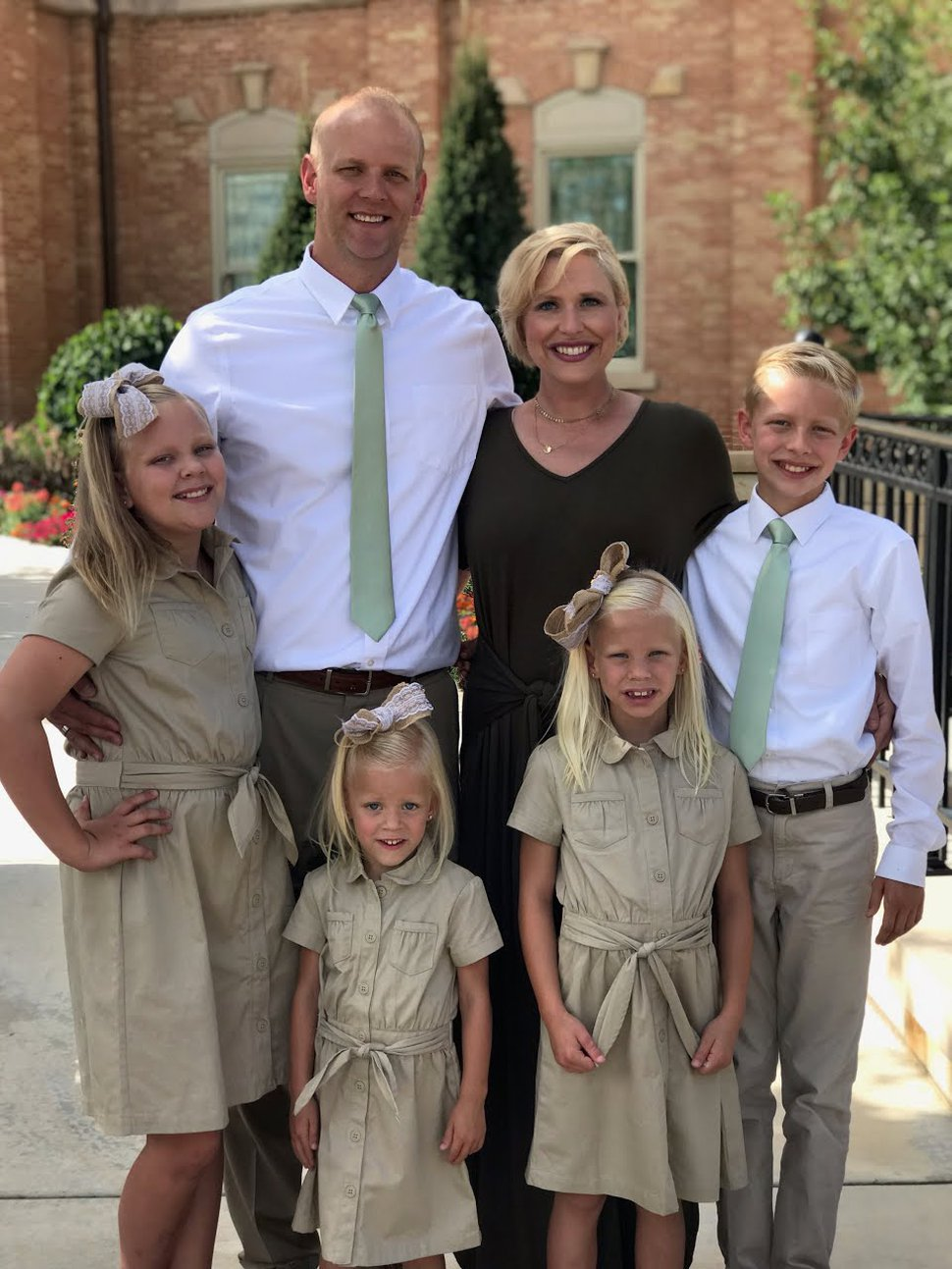 (Photo courtesy of Ashlyn Whitaker) Ashlyn Whitaker, back right, experienced postpartum anxiety and psychosis after having her four children, from left to right, Whitney, Oakley, McKinley and Tycen. Her husband, Shawn, back left, took her to the emergency room twice after having their fourth child.