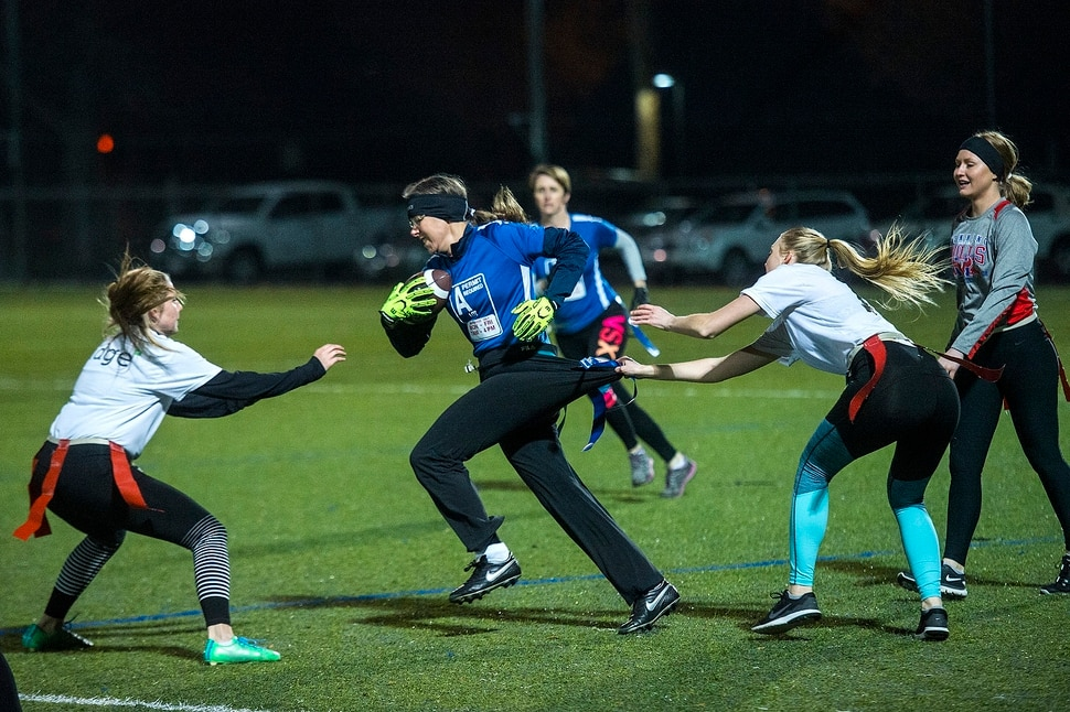 (Chris Detrick | The Salt Lake Tribune) Team A Lot's Denise Stephens runs the ball during the flag football team game against Sim Team at North University Fields in Provo Thursday, November 30, 2017.
