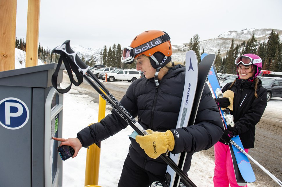 (Rick Egan   The Salt Lake Tribune) Abbigail Nelson tries to figure out the parking kiosk as Gabrielle Kling laughs in the background at Solitude Mountain Resort, Wednesday, Dec. 11, 2019.