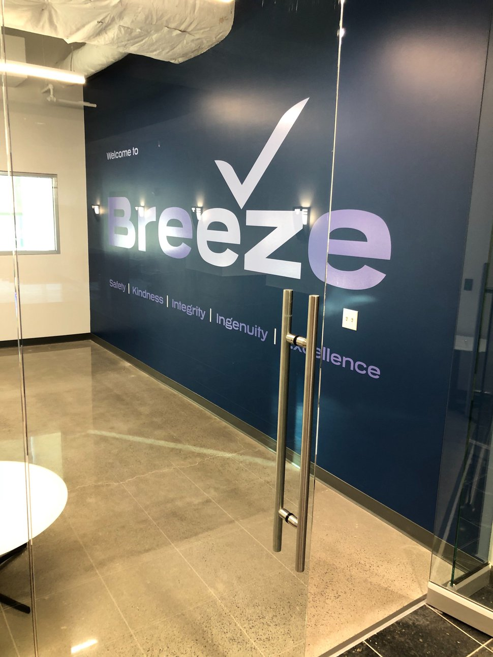 (Lee Davidson   The Salt Lake Tribune) The entrance to the new headquarters of Breeze Airways in Cottonwood Heights.