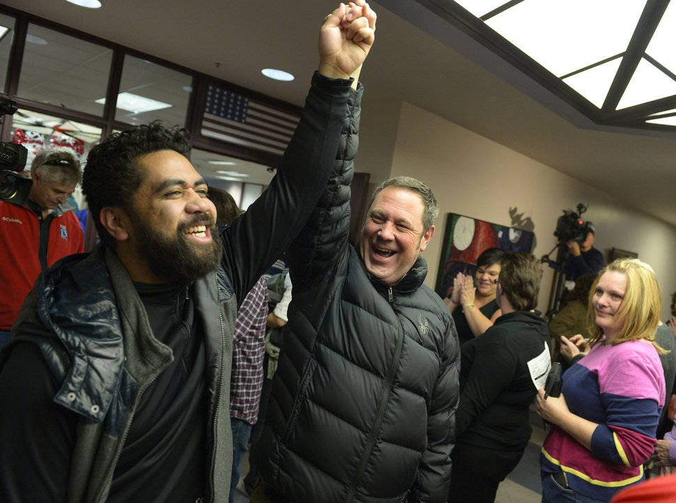 Keith Johnson | The Salt Lake Tribune Brian Morris, right, and his new husband Noni Blake celebrate after they were married by Salt Lake City mayor Ralph Becker outside the Salt Lake County clerks office, Friday, December 20, 2013. A federal judge in Utah Friday struck down the stateÕs ban on same-sex marriage, saying the law violates the U.S. ConstitutionÕs guarantees of equal protection and due process.