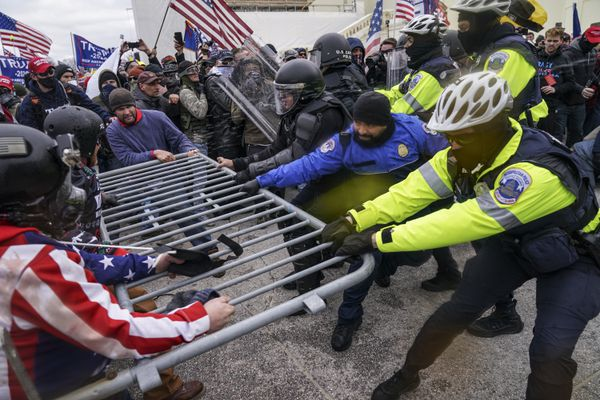 (John Minchillo   AP photo)  In this Jan. 6 photo, rioters try to break through a police barrier at the Capitol in Washington.