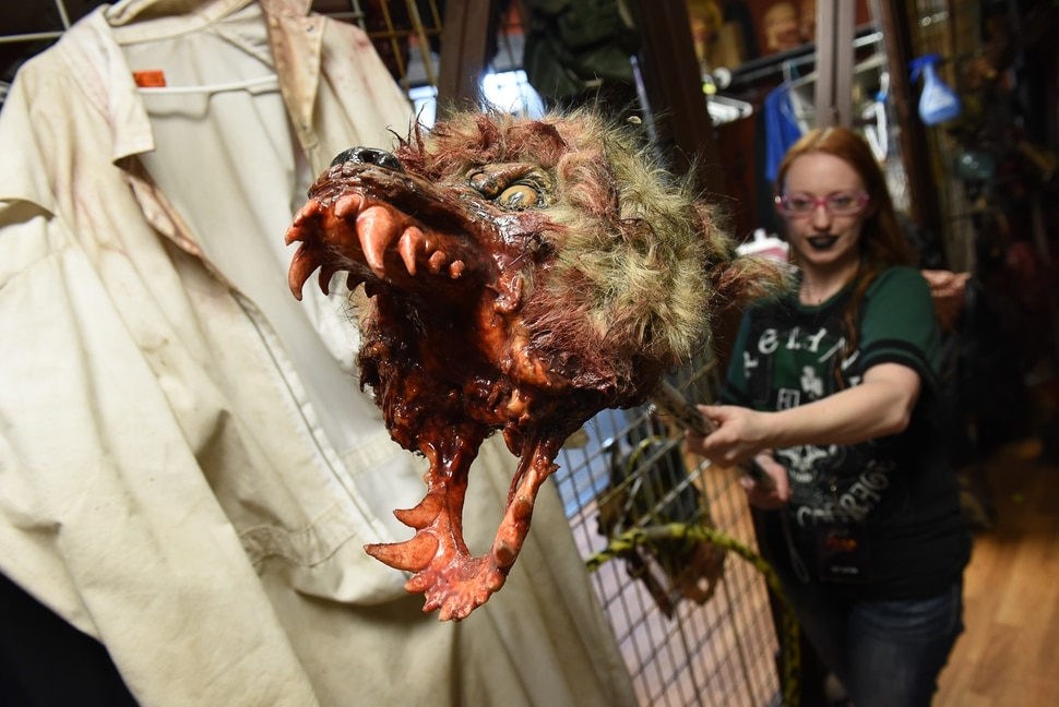(Francisco Kjolseth | The Salt Lake Tribune) Costumer Missy Moody pulls out some of her favorite costumes used at the Fear Factory in Salt Lake. Local politicians fell prey to the zombie apocalypse at the Fear Factory on Thursday, Oct. 12, 2017, for a special event to raise awareness of the Utah Food Bank and kick start donations.