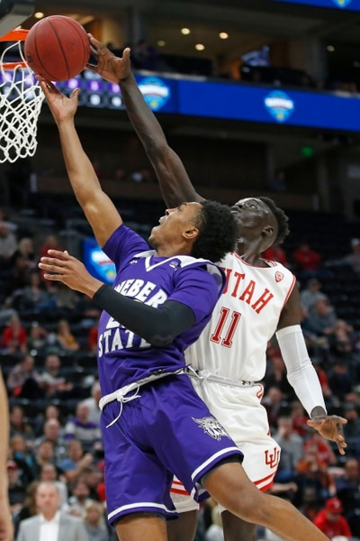 Weber State guard Judah Jordan, left, goes to the basket as Utah guard Both Gach (11) defends in the first half during an NCAA college basketball game Saturday, Dec. 14, 2019, in Salt Lake City. (AP Photo/Rick Bowmer)