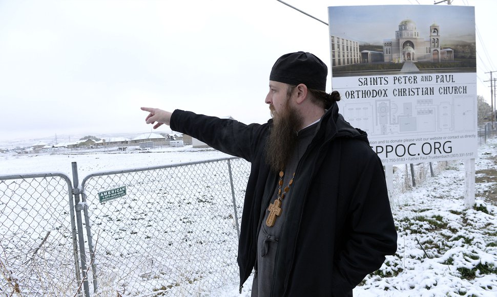 (Al Hartmann | The Salt Lake Tribune) Rev. Justin Havens looks at the open field in Bluffdale where Saints Peter and Paul Orthodox Christian Church wants to build a new church and religious campus.