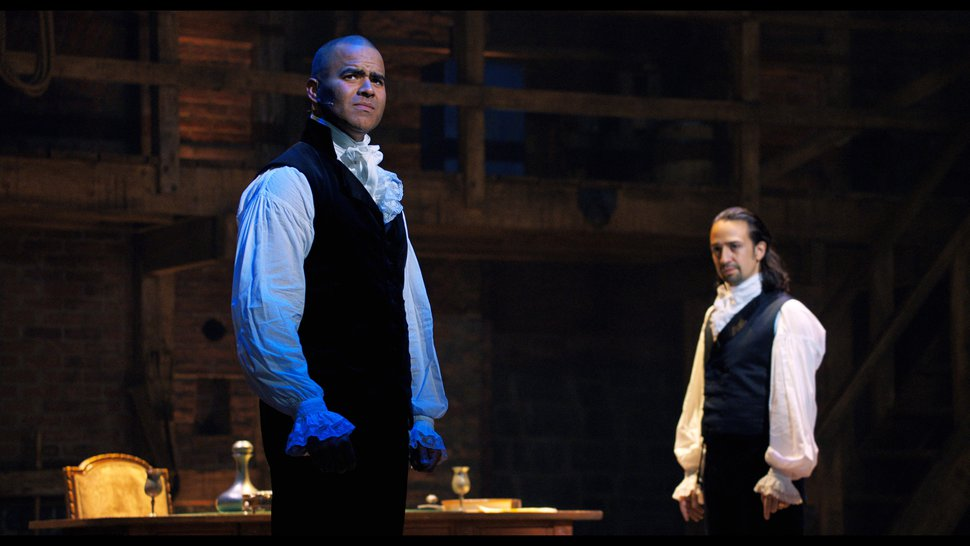 (Disney+ via AP) In this image released by Disney+, Chris Jackson portrays George Washington, left, and Lin-Manuel Miranda portrays Alexander Hamilton in a filmed version of the original Broadway production of