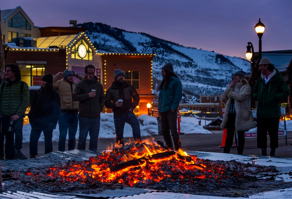 (Rick Egan | The Salt Lake Tribune) People gather around the first-ever Sundance bonfire, a community gathering on Swede Alley, in Park City, Thursday, Jan. 30, 2020.
