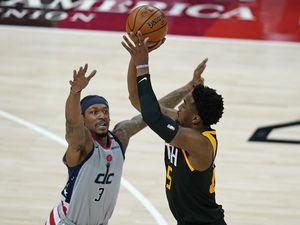 (Rick Bowmer | AP) Utah Jazz guard Donovan Mitchell, right, shoots as Washington Wizards guard Bradley Beal, left, defends in the first half during an NBA basketball game Monday, April 12, 2021, in Salt Lake City.
