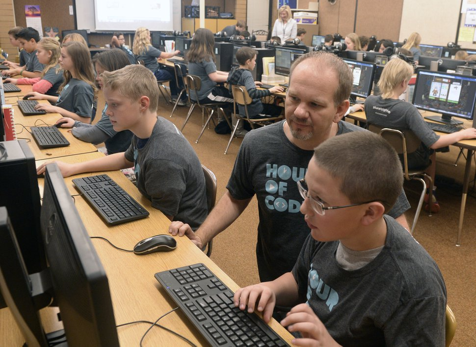 (Al Hartmann | Tribune file photo) Sixth-graders at Layton Elementary School get an introduction to computer programing during an annual Hour of Code from Pluralsight, which has pledged $10 million to computer science education and is looking to expand its horizons by going public.