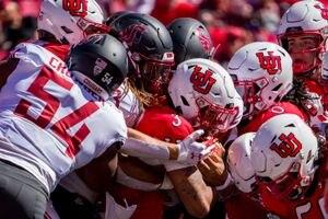 (Trent Nelson  |  The Salt Lake Tribune) Utah Utes quarterback Ja'Quinden Jackson (3) is stopped as the University of Utah hosts Washington State, NCAA football in Salt Lake City on Saturday, Sept. 25, 2021.