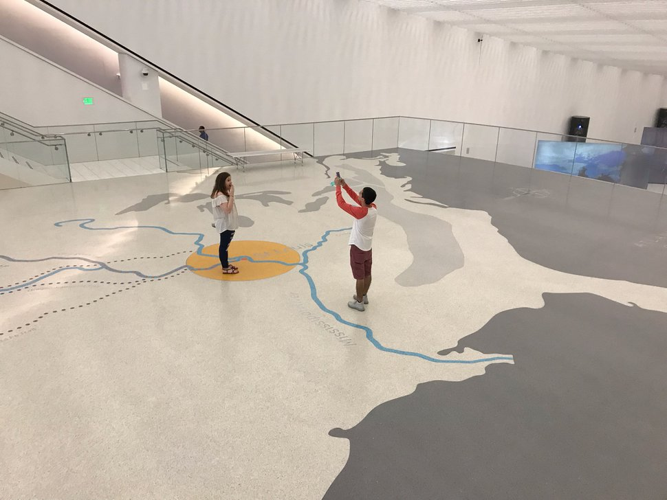 (Nate Carlisle | The Salt Lake Tribune) Visitors to the Gateway Arch museum in St. Louis take a photograph on the floor map near the museum entrance on Aug. 22, 2019. The map shows how St. Louis was a starting point or way station for multiple western trails, including the Mormon Trail.